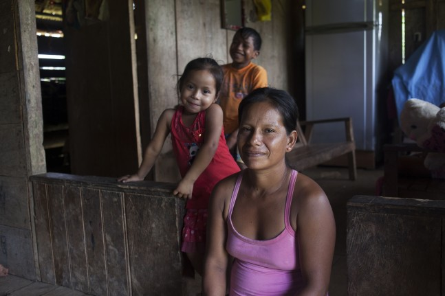 Maribel, who sells chicken broth for a living and two of her children who regularly afflicted by malaria, Peru